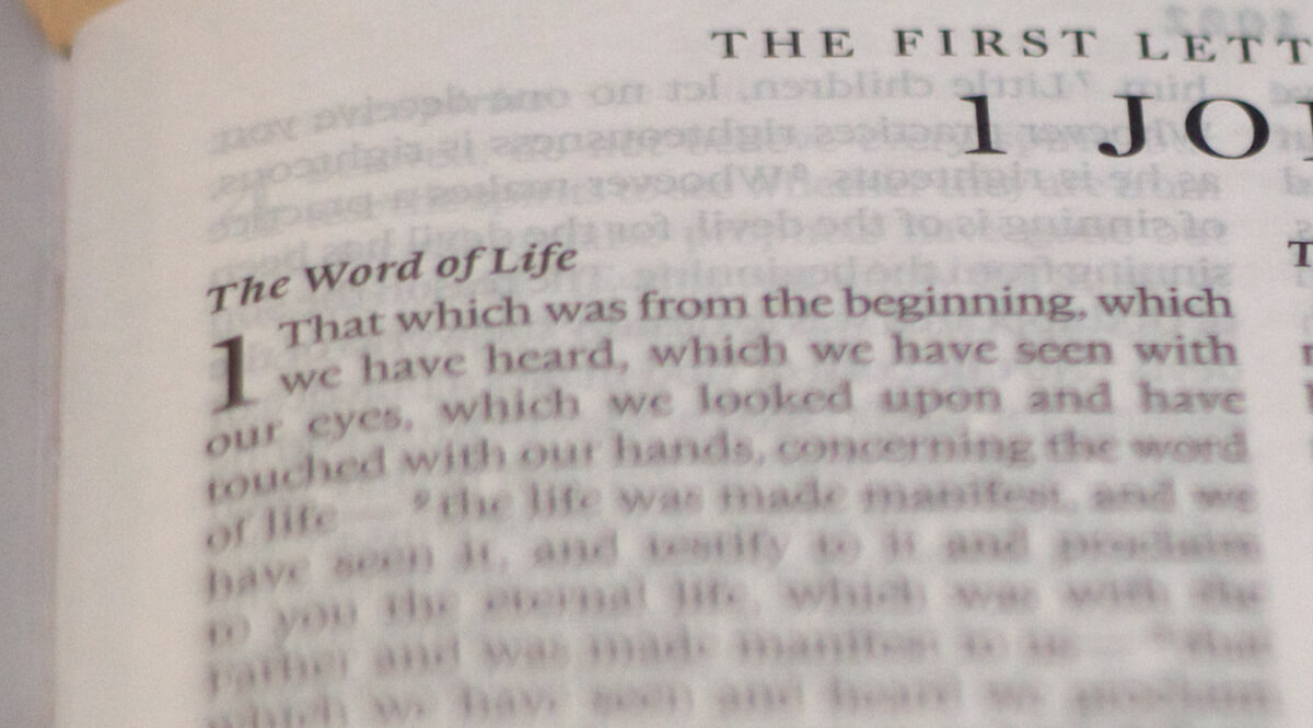 Bible Open to 1 John 1 - The Word of Life
