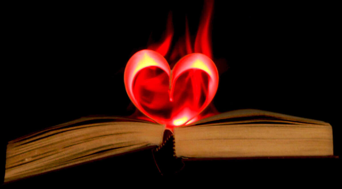 Bible with Pages Forming a Flaming Heart