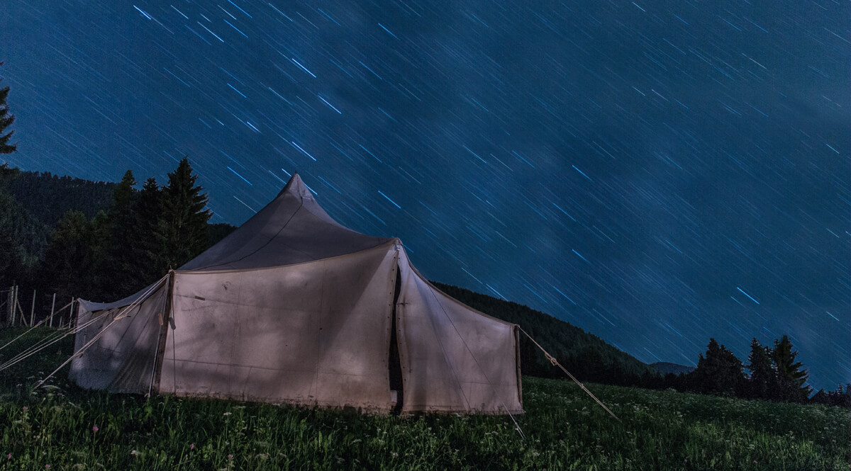 Brown Tent on Green Grass at Night
