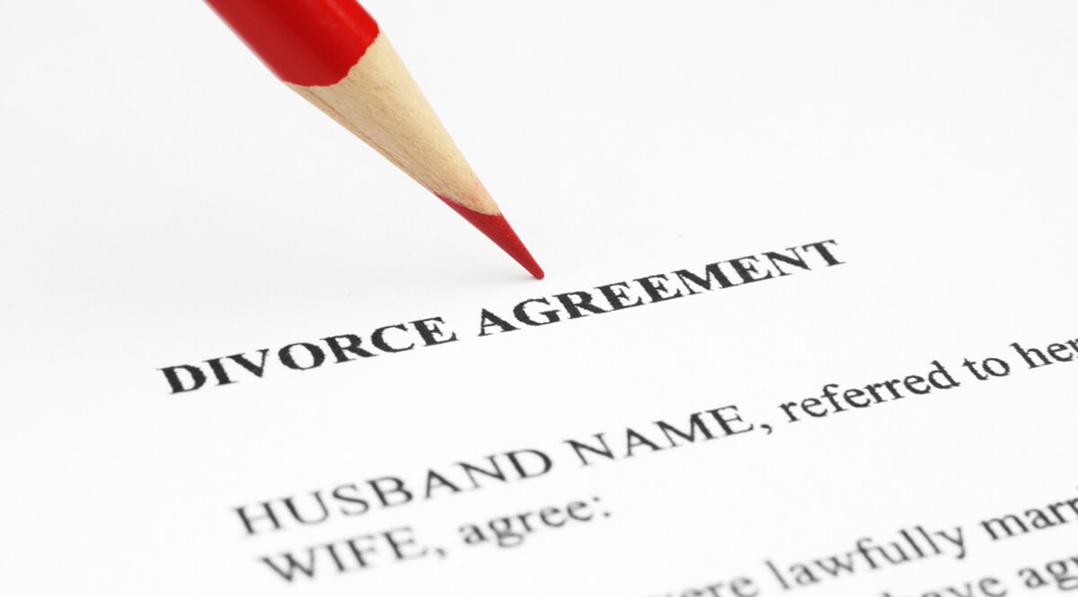 Divorce Agreement with Red Pencil