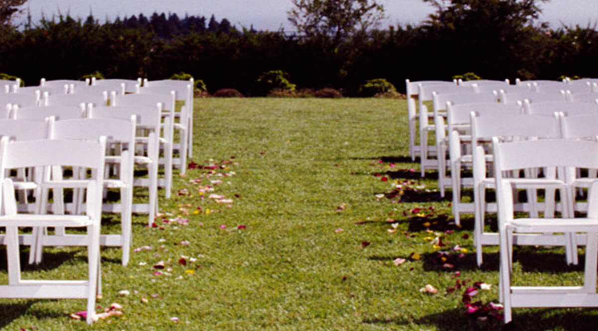 Empty Rows of Chairs at an Outdoor Wedding