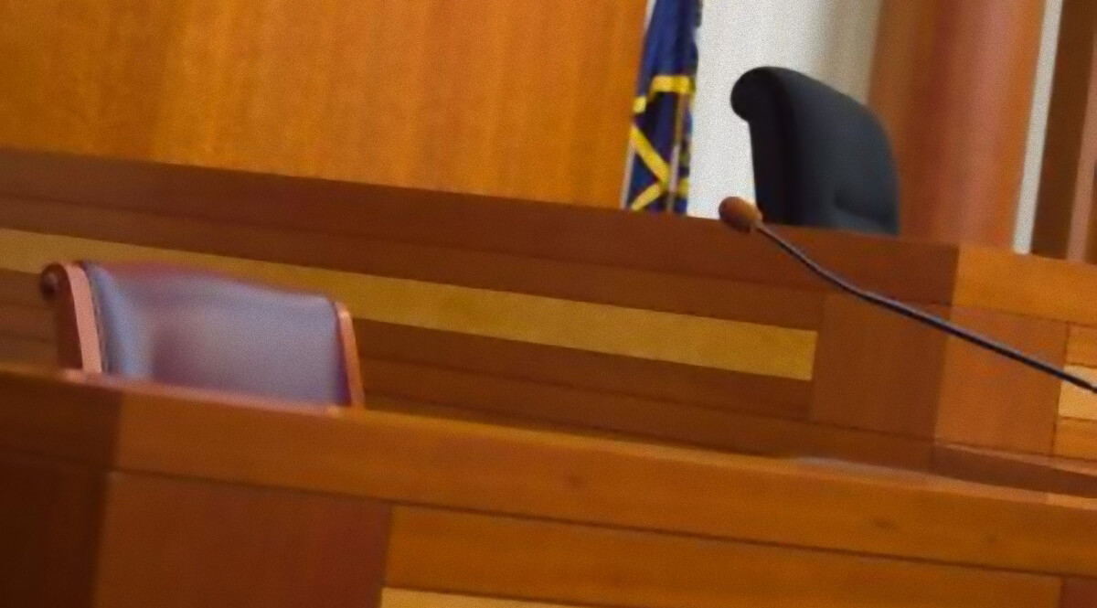 Empty Witness Stand in a Courtroom