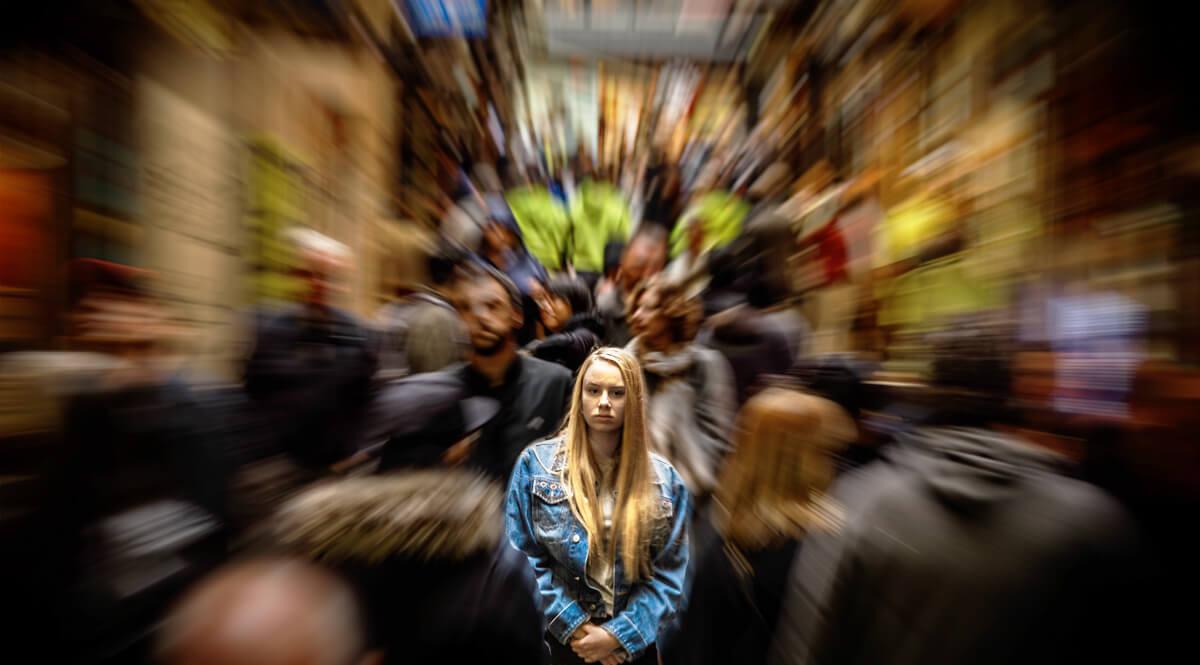 Girl in Denim Jacket in a Crowd