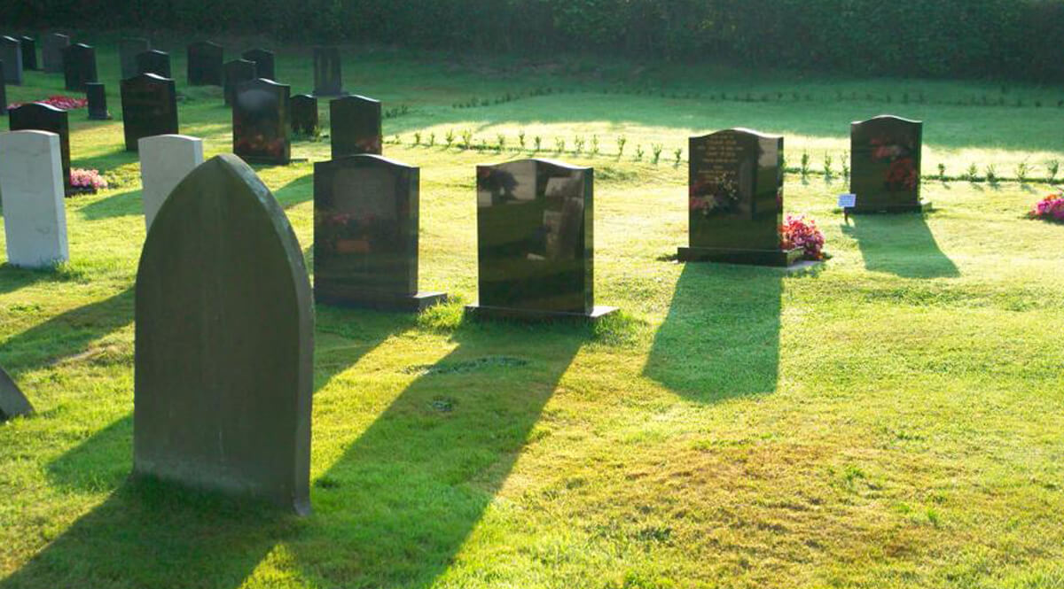 Headstones and Shadows in a Church Graveyard
