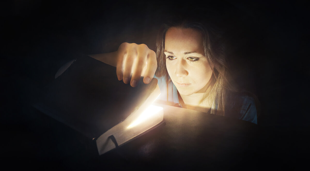 Looking into a Glowing Bible