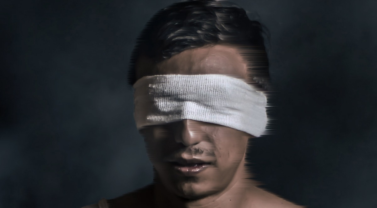 Man with Blindfold in Water