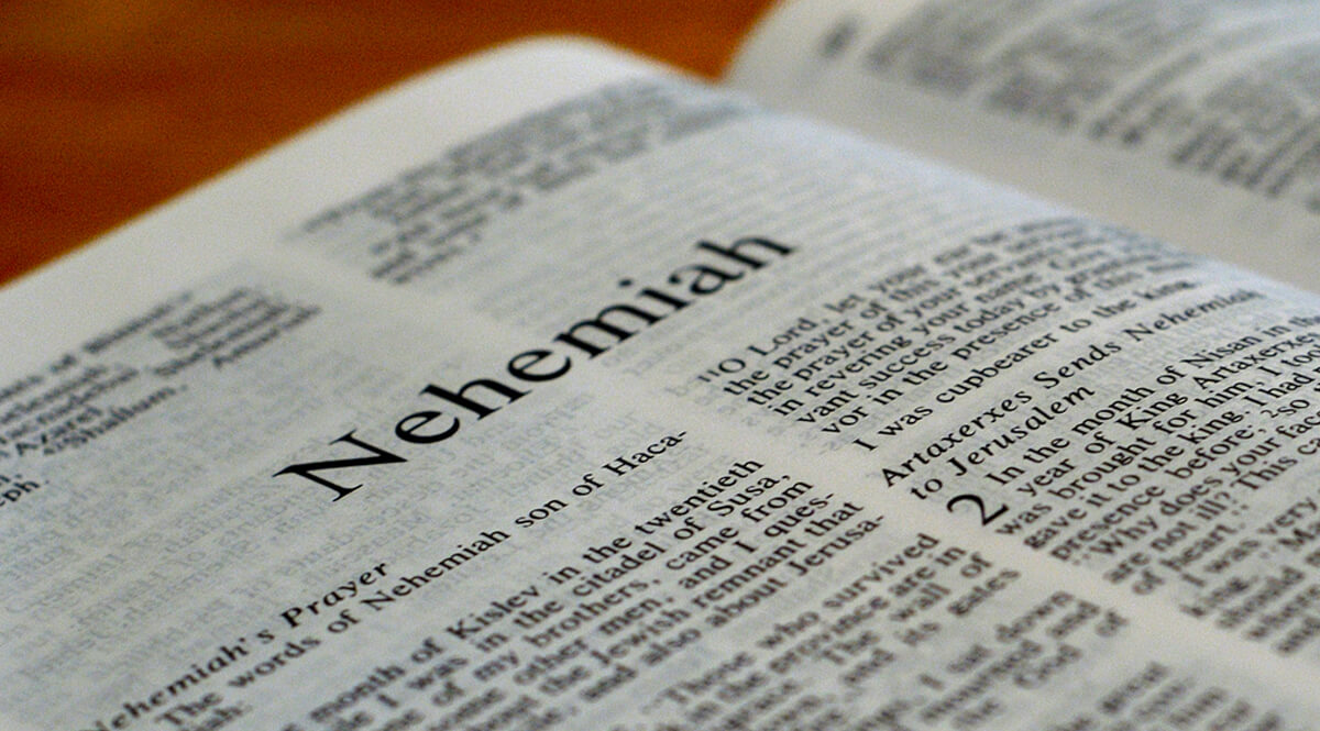 Open Bible at the Book of Nehemiah