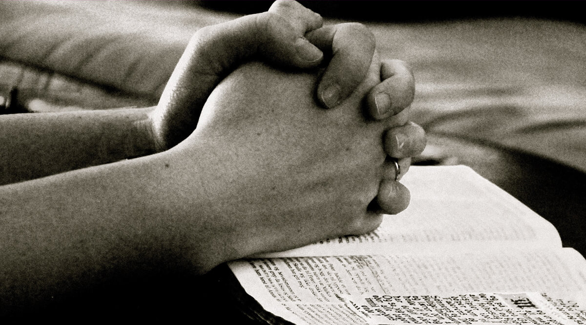 Praying Hands on a Bible - Black and White