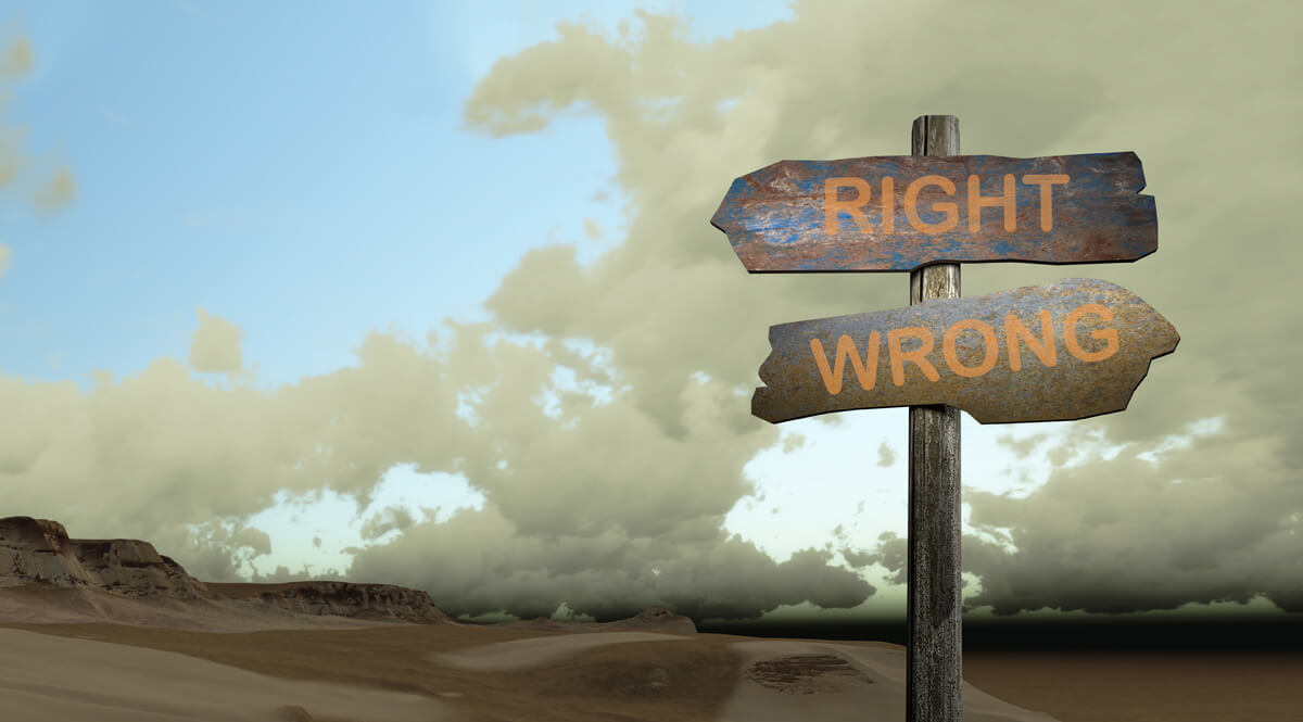 Sign with Directions for Right and Wrong in a Desert Landscape
