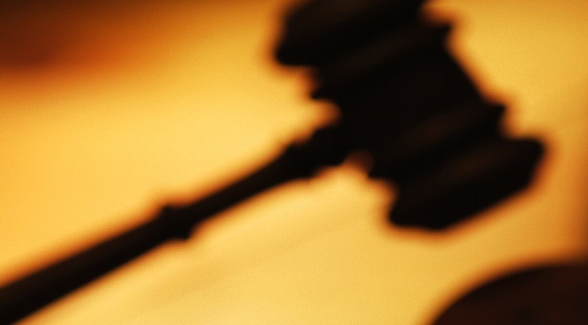 Silhouette of Gavel and Block
